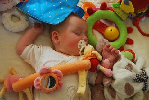 Baby sleeping with pacifier