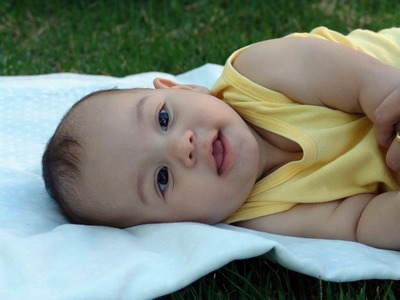 Smiling baby on a blanket
