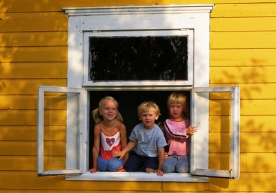 Children sitting on a window