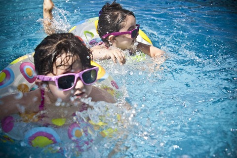 Children with sunglasses in pool