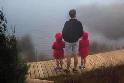 Dad with twin girls outdoor