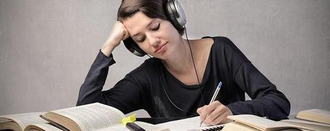 Female student concentrated on exam revisions