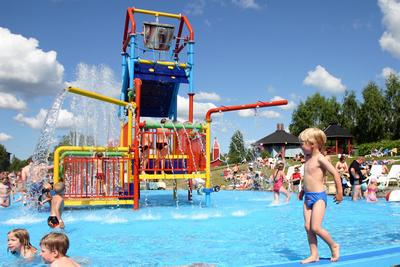 Children having water fun at a public pool