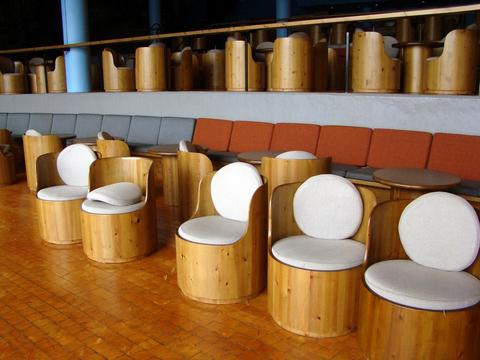 Round wooden chairs and tables with a unique design