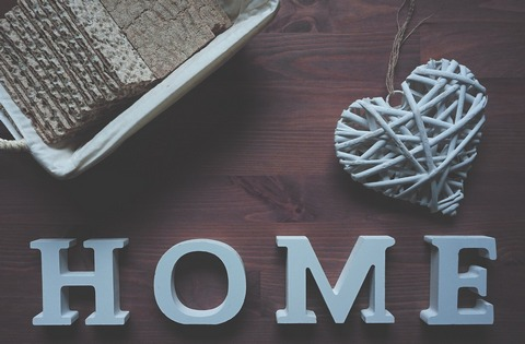 'HOME' sign in pastel blue