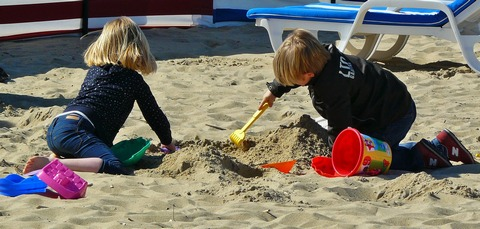 Children playing outdoor in sand pit