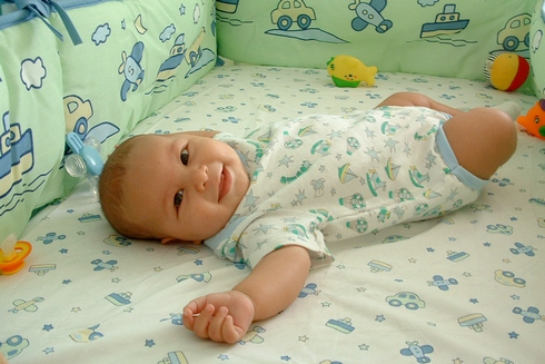 Smiling baby on a bed
