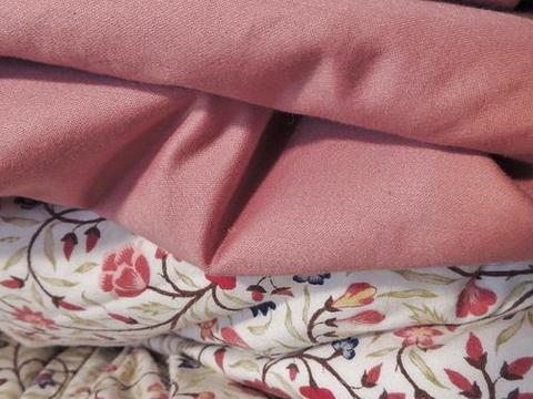 Plain and floral bed sheet designs in pink colour