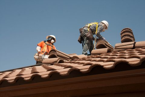 Roof workers at work