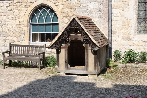 A dog house done in old style with frills